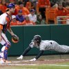 South Carolina\'s Tanner English, right, dives at home plate behind Clemson catcher Garrett Boulware to score a run in their NCAA college baseball game on Friday, March 1, 2013, in Clemson, S.C. (AP Photo/Anderson Independent-Mail, Mark Crammer) GREENVILLE NEWS OUT, SENECA NEWS OUT