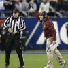 Photo - Florida State head coach Jimbo Fisher, right, argues a call in the first half of the Atlantic Coast Conference Championship NCAA football game against Duke  in Charlotte, N.C., Saturday, Dec. 7, 2013. (AP Photo/Bob Leverone)