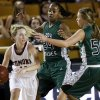 Edmond Memorial\'s Alyssa Hand (14) dribbles away from Edmond Santa Fe\'s Daisha Gonzaque (24) and Taylor Nashert (50) during the Class 6A girls high school basketball state tournament championship game between Edmond Santa Fe and Edmond Memorial at the Mabee Center in Tulsa, Okla., Saturday, March 10, 2012. Santa Fe won, 44-41. Photo by Nate Billings, The Oklahoman