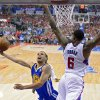 Photo - Golden State Warriors guard Stephen Curry, left, puts up a shot as Los Angeles Clippers center DeAndre Jordan defends during the first half in Game 1 of an opening-round NBA basketball playoff series, Saturday, April 19, 2014, in Los Angeles. (AP Photo/Mark J. Terrill)