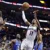Memphis Grizzlies\' Mike Conley (11) goes to the basket between Oklahoma City Thunder\'s Reggie Jackson, left, and Derek Fisher (6) during the second half of an NBA basketball game in Memphis, Tenn., Wednesday, March 20, 2013. Conley scored 24 points in the Grizzlies\' 90-89 overtime victory. (AP Photo/Danny Johnston)