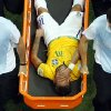 Photo - Brazil's Neymar is carried away on a stretcher during the World Cup quarterfinal soccer match between Brazil and Colombia at the Arena Castelao in Fortaleza, Brazil, Friday, July 4, 2014. (AP Photo/Fabrizio Bensch, pool)