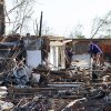 Residents search through what is left of their homes after Wednesday\'s tornado hit Pleasant Grove just west of downtown Birmingham, Ala., on Thursday, April 28, 2011. (AP Photo/Butch Dill)