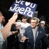 Scott Paterno, left, looks on as students greet his father Penn State football coach Joe Paterno as he arrives at his home, Tuesday, Nov. 8, 2011, in State College, Pa. Paterno\'s support among the Penn State board of trustees was described as