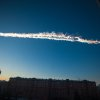 Photo - In this photo provided by Chelyabinsk.ru a meteorite contrail is seen over Chelyabinsk on Friday, Feb. 15, 2013. A meteor streaked across the sky of Russia's Ural Mountains on Friday morning, causing sharp explosions and reportedly injuring around 100 people, including many hurt by broken glass. (AP Photo/Chelyabinsk.ru)