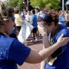 Allegiance Credit Union runner Terri Talley consoles Amy Petty when she is overcome by emotions after the half marathon during the 10th anniversary of the Oklahoma City Memorial Marathon Sunday, April 25, 2010 in Oklahoma City. Talley and Petty were injured during the bombing fifteen years ago. Photo by Doug Hoke, The Oklahoman.