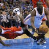 Oklahoma City\'s Reggie Jackson (15) falls down beside Los Angeles Clippers\' Darren Collison (2) during an NBA basketball game between the Oklahoma City Thunder and the Los Angeles Clippers at Chesapeake Energey Arena in Oklahoma City, Thursday, Nov. 21, 2013. Photo by Bryan Terry, The Oklahoman