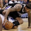 Photo - Sacramento Kings center DeMarcus Cousins, top, lands on top of Dallas Mavericks' Derek Fisher (6) chasing a loose ball in the first half of an NBA basketball game Monday, Dec. 10, 2012, in Dallas. (AP Photo/Tony Gutierrez)