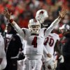 Louisville quarterback Will Stein (4) celebrates at the end of an NCAA college football game against Rutgers in Piscataway, N.J., Thursday, Nov. 29, 2012. Louisville won 20-17. (AP Photo/Mel Evans)
