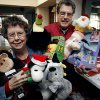 Charmaine and Bob Magarian show some of the toys collected for the Norman annual Community Christmas Dinner in Norman, Oklahoma on Thursday, December 14, 2006. by Steve Sisney/The Oklahoman