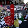 A foam finger stands at a makeshift memorial on Boylston Street in Boston, near the blast site of the Boston Marathon explosions, Thursday, April 18, 2013. The city continues to cope following Monday\'s explosions near the finish line of the marathon. (AP Photo/Julio Cortez)