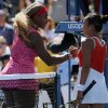 Photo - Serena Williams, of the United States, left, greets Vania King, of the United States, at the net after winning their second round match of the 2014 U.S. Open tennis tournament, Thursday, Aug. 28, 2014, in New York. (AP Photo/Elise Amendola)