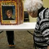 Jackson West, 8, laughs from behind a Harry Potter cutout as his great-grandmother Ione Hause walks past. [Photo by Bryan Terry, The Oklahoman]