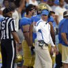 Photo -   UCLA head coach Jim Mora, right, gestures to an official during the first half of their NCAA football game against Nebraska, Saturday, Sept. 8, 2012, in Pasadena, Calif. (AP Photo/Mark J. Terrill)