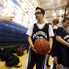 Van Hoosen\'s Owen Groesser warms up after halftime of a middle school basketball game against Reuther, Thursday, Jan. 24, 2013, at Rochester High School in Rochester, Mich. Groesser, an eight-grader with Dwon Syndrome, made ESPN\'S SportsCenter Top 10 Plays after hitting two 3-pointers in the first game he got to play this season on Wednesday. (AP Photo/Detroit Free Press, Andre J. Jackson) DETROIT NEWS OUT; NO SALES; MAGS OUT; MANDATORY CREDIT