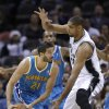 New Orleans Hornets\' Greivis Vasquez, left, looks to move the ball against San Antonio Spurs\' Tim Duncan during the first quarter of an NBA basketball game, Friday, Dec. 21, 2012, in San Antonio. (AP Photo/Eric Gay)
