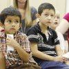 Kindergartners Brayan, Andy, and Cierra listen intently as Oklahoma children\'s author Meredith Garrett reads her book