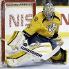 Nashville Predators goalie Pekka Rinne, of Finland, blocks a shot by the Detroit Red Wings during the first period of an NHL hockey game Tuesday, Feb. 19, 2013, in Nashville, Tenn. (AP Photo/Mark Humphrey)