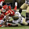 Photo -   Kansas City Chiefs running back Jamaal Charles (25) is tackled by New Orleans Saints linebacker Curtis Lofton (50) in overtime of an NFL football game in New Orleans, Sunday, Sept. 23, 2012. The Chiefs won 27-24. (AP Photo/Bill Haber)