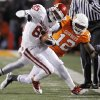 Oklahoma\'s Ryan Broyles (85) is brought down by Oklahoma State\'s Johnny Thomas (12) during the Bedlam college football game between the University of Oklahoma Sooners (OU) and the Oklahoma State University Cowboys (OSU) at Boone Pickens Stadium in Stillwater, Okla., Saturday, Nov. 27, 2010. Photo by Chris Landsberger, The Oklahoman