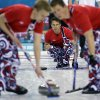 Photo - Norway's Thomas Ulsrud delivers the rock to his sweepers during a round robin match against Denmark at the 2014 Winter Olympics, Monday, Feb. 17, 2014, in Sochi, Russia. (AP Photo/Morry Gash)