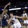 Golden State Warriors\' Klay Thompson (11) tries to dribble around Indiana Pacers\' George Hill (3) during the first half of an NBA basketball game in Oakland, Calif., Saturday, Dec. 1, 2012. (AP Photo/Marcio Jose Sanchez)
