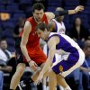 Toronto Raptors\' Andrea Bargnani, of Italy, left, pressures Phoenix Suns\' Goran Dragic, of Slovenia, during the first half of an NBA basketball game, Wednesday, March 6, 2013, in Phoenix. (AP Photo/Matt York)