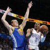 Oklahoma City\'s Russell Westbrook (0) goes past Golden State\'s Andris Biedrins (15) during an NBA basketball game between the Oklahoma City Thunder and the Golden State Warriors at Chesapeake Energy Arena in Oklahoma City, Wednesday, Feb. 6, 2013. Photo by Bryan Terry, The Oklahoman