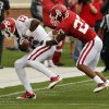 Trey Metoyer (17) is pushed out of bounds after a catch by Kass Everett (23) during the University of Oklahoma (OU) football team\'s annual Red and White Game at Gaylord Family/Oklahoma Memorial Stadium on Saturday, April 14, 2012, in Norman, Okla. Photo by Steve Sisney, The Oklahoman