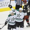Photo - Dallas Stars center Cody Eakin (20) congratulates teammate Shawn Horcoff after he scored a goal against the Phoenix Coyotes during the second period of their NHL hockey game, Tuesday, Feb. 4, 2014 in Glendale, Ariz. (AP Photo/The Arizona Republic, David Kadlubowski)