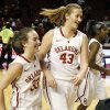 Oklahoma\'s Eden Williams (33) and Tara Dunn (43) leave the court along with Oklahoma\'s Aaryn Ellenberg (3) after a women\'s college basketball game between the University of Oklahoma (OU) and Cal State Northridge at the Lloyd Noble Center in Norman, Okla., Saturday, Dec. 29, 2012. OU won, 79-57. Photo by Nate Billings, The Oklahoman
