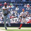 Photo - Cincinnati Reds third baseman Ramon Santiago, left, makes the running  throw to first to get the out on San Diego Padres' Chris Denorfia in the seventh inning of a baseball game on Wednesday, July 2, 2014, in San Diego.  The Padres won 3-0. (AP Photo/Lenny Ignelzi)