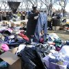 A woman looks at a pair of jeans amongst the pile of clothing in front of Long Beach city hall donated for victims of Superstorm Sandy on Tuesday, Nov 6, 2012, in Long Beach, N.Y. (AP Photo/Kathy Kmonicek) ORG XMIT: NYKK128