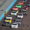Drivers cross the start/finish line under the green flag for the start of the NASCAR Nationwide Series auto race Saturday, Nov. 10, 2012, at Phoenix International Raceway in Avondale, Ariz.(AP Photo/Paul Connors)