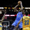 Oklahoma City\'s Kevin Durant (35) shoots the ball over New Orleans Hornets Darius Miller (2) and Brian Roberts (22) during the first half of an NBA basketball game in New Orleans, Friday, Nov. 16, 2012. (AP Photo/Jonathan Bachman)