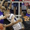 TCU guard Christian Gore, center, battles Oklahoma State\'s Leyton Hammonds, left, and Markel Brown (22) in the first half of an NCAA college basketball game, Monday, Feb. 24, 2014, in Fort Worth, Texas. (AP Photo/Brandon Wade)