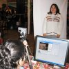 Photo - A Mexican national living in  Oklahoma gets her photo taken for a Meixcan ID card Saturday morning at Chelino's restaurant in Oklahoma City. PHOTO BY JOHNNY JOHNSON, THE OKLAHOMAN