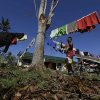 A typhoon evacuee prepares a clothesline at an evacuation center at Maparat township, Compostela Valley in southern Philippines Saturday Dec. 8, 2012. Search and rescue operations following typhoon Bopha that killed nearly 600 people in the southern Philippines have been hampered in part because many residents of this ravaged farming community are too stunned to assist recovery efforts, an official said Saturday. (AP Photo/Bullit Marquez)