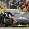 Photo - Jeff Gordon (24) and Joey Logano make pit stops during the NASCAR Sprint Cup Series Pure Michigan 400 auto race at Michigan International Speedway in Brooklyn, Mich., Sunday, Aug. 17, 2014. (AP Photo/Paul Sancya)