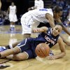 Photo - Connecticut guard Bria Hartley (14) tries to control the ball after colliding with Memphis guard Mooriah Rowser (24) in the first half of an NCAA college basketball game Saturday, Jan. 4, 2014, in Memphis, Tenn. (AP Photo/Mark Humphrey)