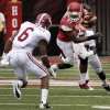 Photo -   Arkansas quarterback Brandon Mitchell (17) tries to get past Alabama defensive back Ha'Sean Clinton-Dix (6) defensive back Nick Perry during the first quarter of an NCAA college football game in Fayetteville, Ark., Saturday, Sept. 15, 2012. (AP Photo/Danny Johnston)