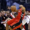 Toronto Raptors\' Kyle Lowry falls to the court in the first half of an NBA basketball game against the Los Angeles Clippers in Los Angeles, Sunday, Dec. 9, 2012. (AP Photo/Jae C. Hong)