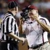 Photo -   Troy coach Larry Blakeney argues with a referee in the first half of an NCAA college football game against Mississippi State in Troy, Ala., Saturday, Sept. 15, 2012. (AP Photo/Dave Martin)