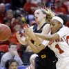 Photo - Nebraska guard Tear'a Laudermill, right, and Iowa guard Melissa Dixon fight for the ball in the first half of an NCAA college basketball game in the finals of the Big Ten women's tournament in Indianapolis, Sunday, March 9, 2014. (AP Photo/Michael Conroy)