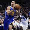 Golden State Warriors shooting guard Stephen Curry (30) drives to the basket as Dallas Mavericks\' Darren Collison (4) defends in the first half of an NBA basketball game, Monday, Nov. 19, 2012, in Dallas. (AP Photo/Tony Gutierrez)