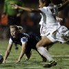Penn State\'s Taylor Schram, left, falls as Florida State\'s Casey Short, right, clears a ball during an NCAA women\'s college soccer tournament semifinal, Friday, Nov. 30, 2012, in San Diego. (AP Photo/Gregory Bull)
