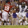 TCU \'s Trevone Boykin (2) looks to get past Oklahoma\'s Eric Striker (19) during the college football game between the University of Oklahoma Sooners (OU) and the Texas Christian University Horned Frogs (TCU) at the Gaylord Family-Oklahoma Memorial Stadium on Saturday, Oct. 5, 2013 in Norman, Okla. Photo by Chris Landsberger, The Oklahoman