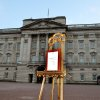 An easel stands in the forecourt of Buckingham Palace in London to announce the birth of a baby boy, at 4.24pm to the Duke and Duchess of Cambridge at St Mary\'s Hospital in west London, Monday July 22, 2013. The notification was set up facing the gates for public view. The child is now third in line to the British throne. (AP Photo/John Stillwell, Pool)