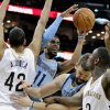 Photo - Memphis Grizzlies' Mike Conley (11) cuts through New Orleans Pelicans' Alexis Ajinca (42), Grizzlies' Marc Gasol (33) and Pelicans' Anthony Morrow (3) in the first half of an NBA basketball game in New Orleans, Wednesday, March 12, 2014. (AP Photo/Scott Threlkeld)