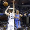 Oklahoma City\'s Russell Westbrook (0) passes the ball round Memphis\' Marc Gasol (33) during Game 6 in the first round of the NBA playoffs between the Oklahoma City Thunder and the Memphis Grizzlies at FedExForum in Memphis, Tenn., Thursday, May 1, 2014. Photo by Bryan Terry, The Oklahoman